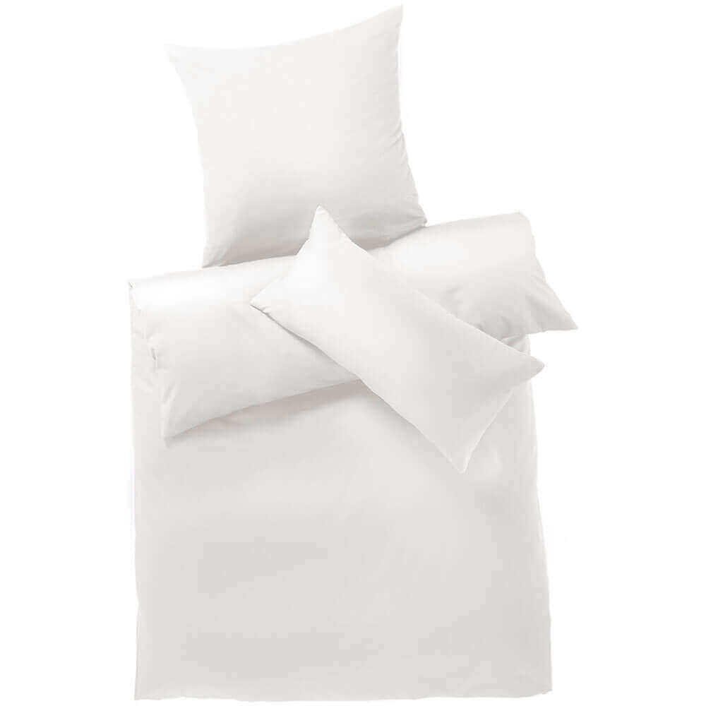 Bed linen is standard organic cotton, white